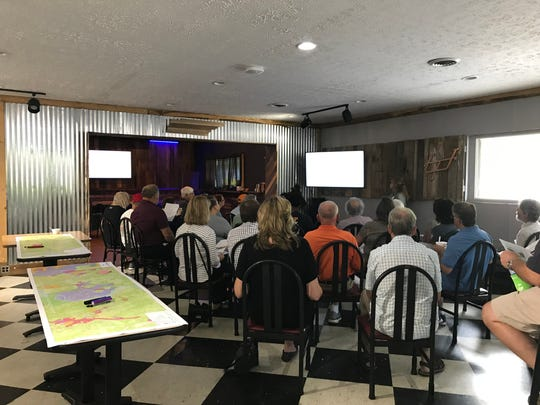 Community members listen about the upcoming plans at the John Sevier Highway committee meeting at SoKno Market. Sept. 9, 2018