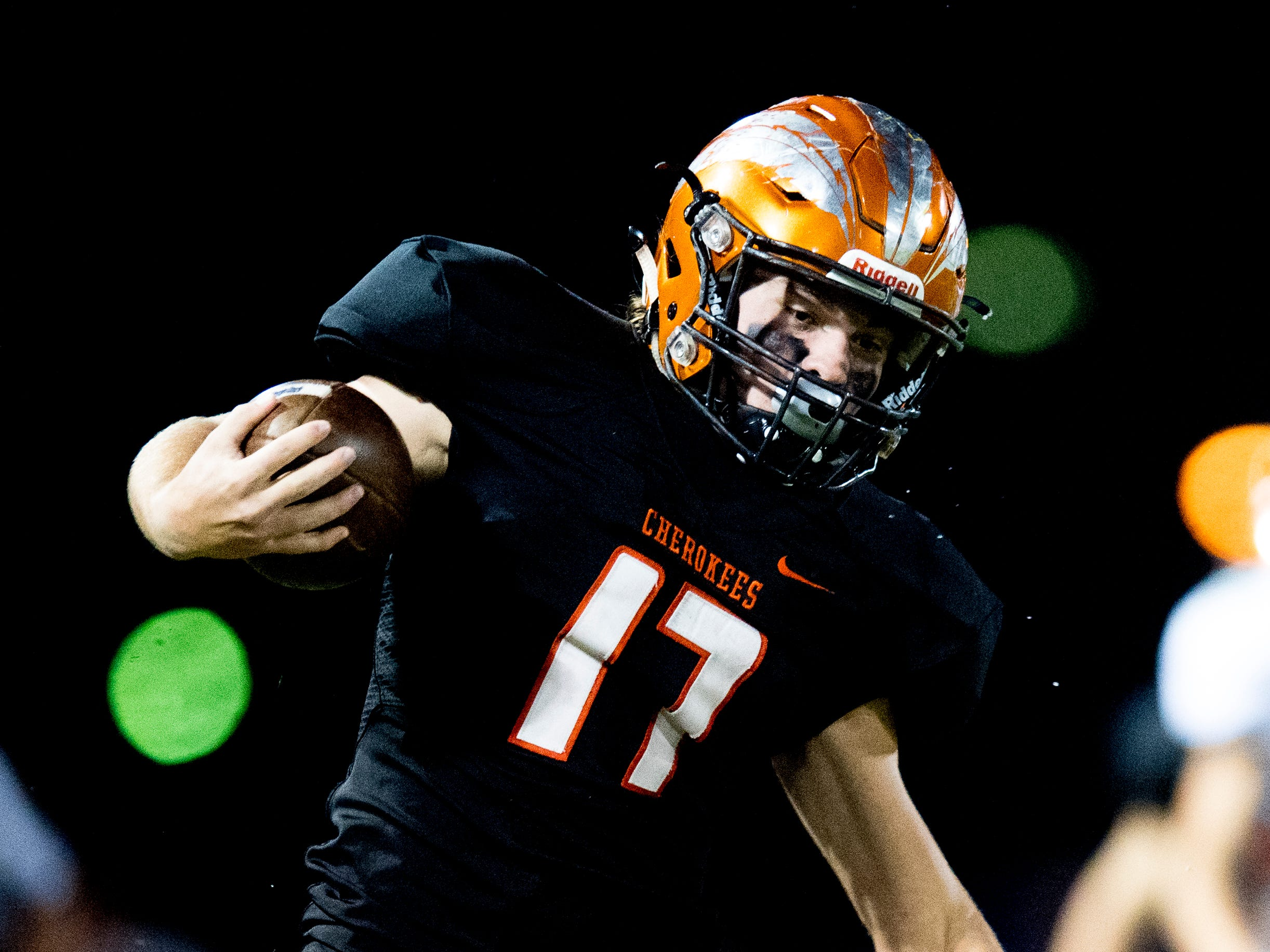 Greenback's Cole Riddle (17) runs by Grace Christian's Gage Maynard (10) during a football game between Greenback and Grace Christian at Greenback High School in Greenback, Tennessee on Thursday, September 20, 2018.