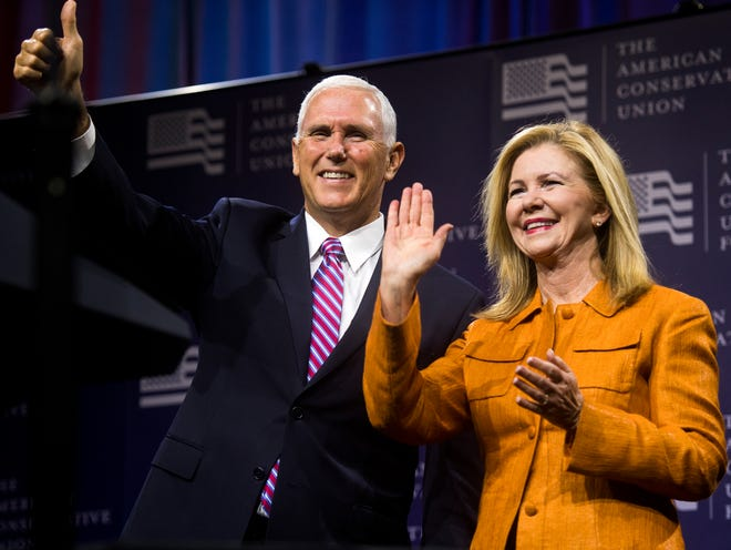 Vice President Mike Pence stands with Republican Senate candidate U.S. Rep. Marsha Blackburn at the American Conservative Union's CPAC/365 Knoxville event at the Knoxville Convention Center on Friday, Sept. 21, 2018.