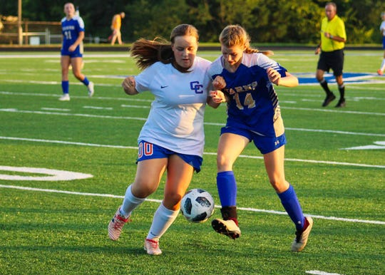 Hannah Stafford #14 (right) is fighting for the ball with Campbell County defender as she makes her way towards the goal during a home game Tuesday, Aug. 28.