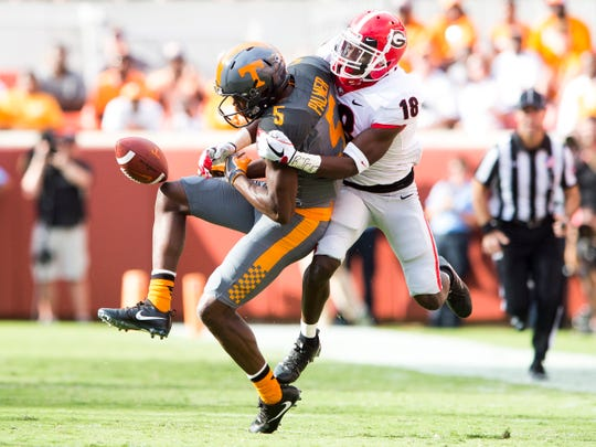 Tennessee wide receiver Josh Palmer (5) misses a catch while defended by Georgia defensive back Deandre Baker (18) which led to Georgia intercepting the ball during Tennessee's game against Georgia in Neyland Stadium on Saturday, Sept. 30, 2017.