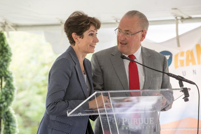 Beatriz, left, and Edmund Schweitzer III discuss plans for a 100,000-square-foot Schweitzer Engineering Laboratories research facility near the corner of U.S. 231 and Indiana 26 in West Lafayette. Schweitzer, a Purdue grad, had groundbreaking ceremonies Friday in Purdue's Discovery Park District.