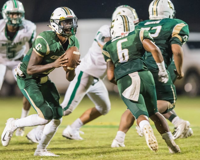 Crowley quarterback Marquis Garrett hands the ball off to Jonteyvan Marks in a District 3-5A matchup against Eunice on Sept. 20, 2018.
