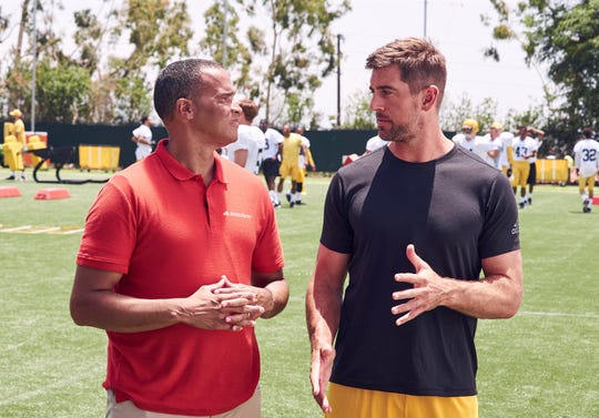 Patrick Minnis and Aaron Rodgers tape a commercial for State Farm Insurance