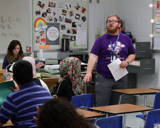 Iroquois High School teacher Scott Arico talks to his third period science class about the test they are getting ready to take. 