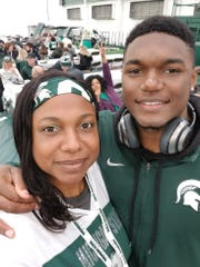 Michigan State linebacker Brandon Bouyer-Randle poses with his mother, Nikkie Bouyer, a former Lansing Sexton and Clemson University track star.