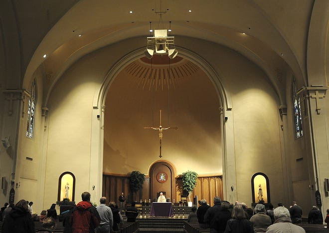 Mass is celebrated at St. Mary Cathedral in Lansing in this file image from 2012.