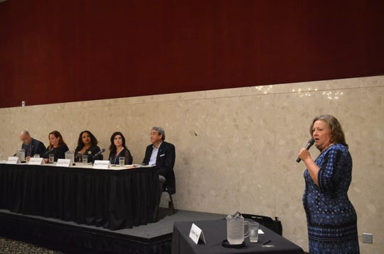 Lansing State Journal Executive Editor Stephanie Angel introduces members of the Acquaintance/Nice Guy Sexual Offenders panel Friday, Sept. 21, 2018.