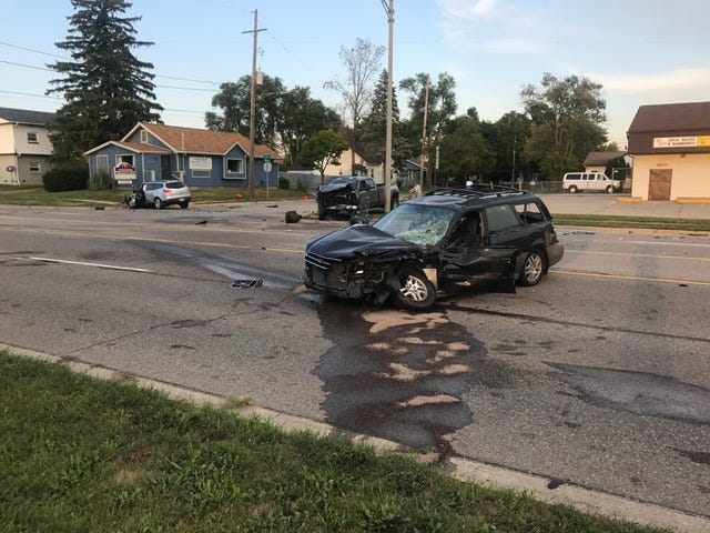 Three people were injured, two seriously, in a crash involving three vehicles Thursday evening on North East Street in Lansing.
