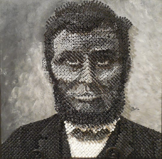 """The Viewers' Choice for three-dimensional work was awarded to Roger D. Booth for his mixed media piece titled """"The Great Emancipator."""""""