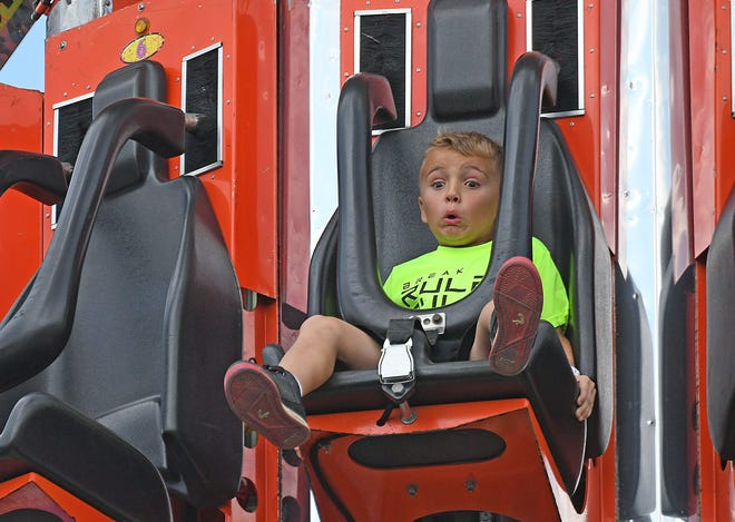 Kaleb Fultz, 7, of Mansfield, can't hide his fear as he rides the Shock Drop ride at the Ashland County Fair on Friday.