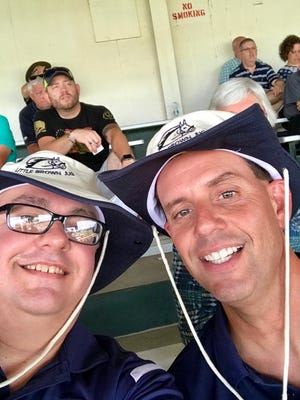 """Rob McCurdy, left, and Jamie """"Jimmy"""" Stall show off their new hats at this year's Little Brown Jug."""