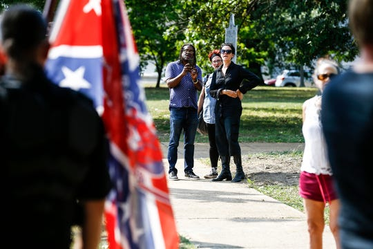 Counterprotesters are seen observing the Confederate 901 group near Health Sciences Park on September 21.