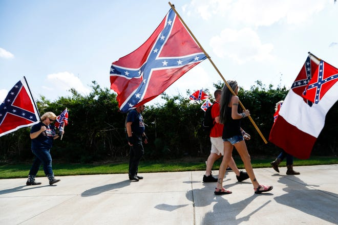 September 21 2018 - Members from the group Confederate 901 walk towards the Big River Crossing. The group is upset over the removal of statues of Confederate President Jefferson Davis and Gen. Nathan Bedford Forrest from Memphis parks in December and the July 28 removal of additional memorabilia.