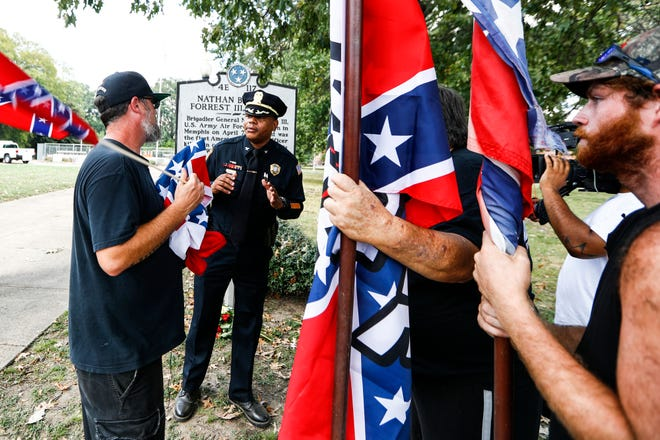 In a September 2018 photo, Memphis police officer P. Wright Jr. talks with a member of the Confederate 901 group near Health Sciences Park. The group is upset over the July 28 removal of additional Confederate memorabilia from a Memphis park and the removal of statues of Confederate President Jefferson Davis and Gen. Nathan Bedford Forrest.