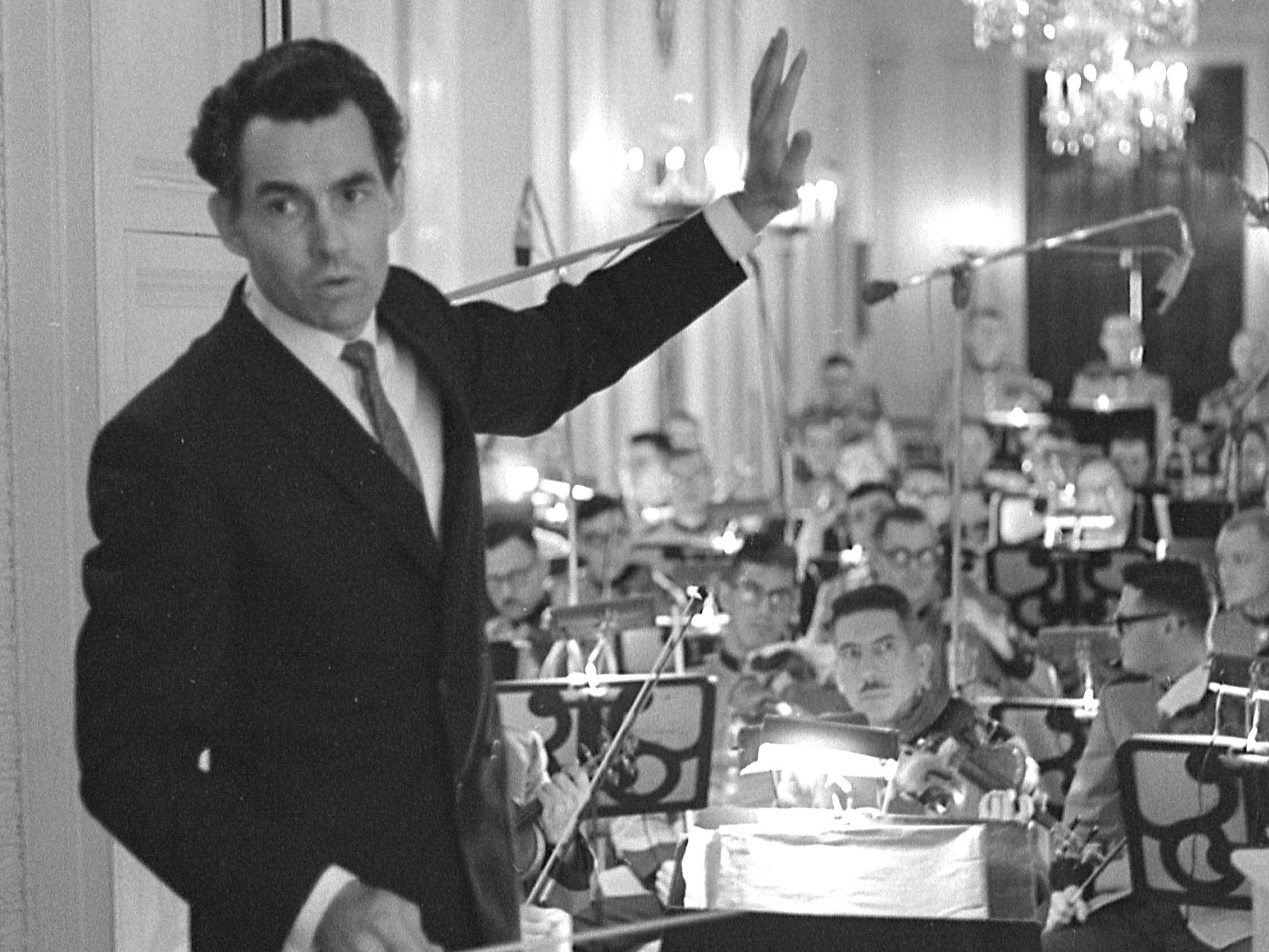 Kenneth Schermerhorn directs the Marine Band at the White House for a performance by the American Ballet Theatre on May 26, 1968. His wife, ballerina Lupe Serrano, was in the ballet company. Four months later, Schermerhorn took over as conductor and music director of the Milwaukee Symphony Orchestra.