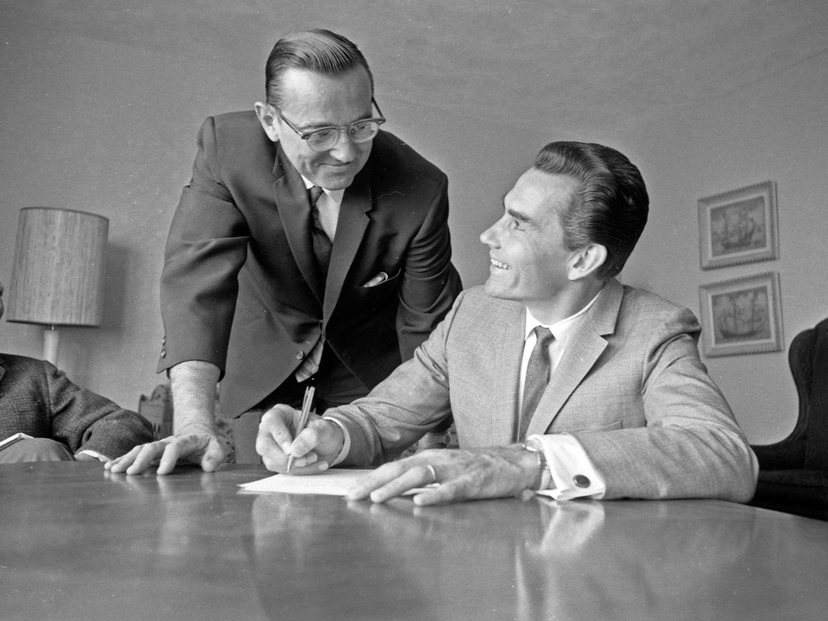 Kenneth Schermerhorn (right) signs his contract to become music director and conductor of the Milwaukee Symphony Orchestra on Sept. 6, 1967, in this unpublished Milwaukee Journal photo. (The other men in the photo weren't identified.) The Milwaukee Sentinel reported he signed a two-year contract with an option for a third, at $30,000 a year. Schermerhorn was 37 at the time.