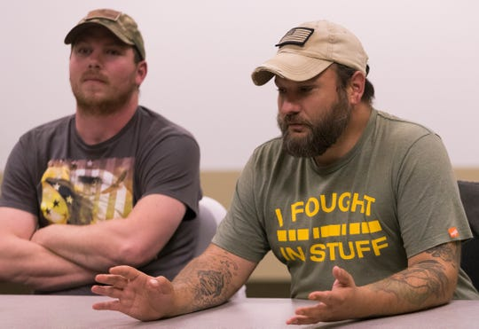 Army veteran Samuel Hipp (right) talks about his service while fellow veteran Zach Nelson listens while participating in a discussion with a group of mental health professionals Thursday at Fort McCoy.