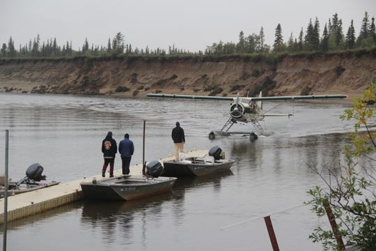 A float plane arrives at the dock at Alagnak Lodge on the Alagnak River in Alaska.