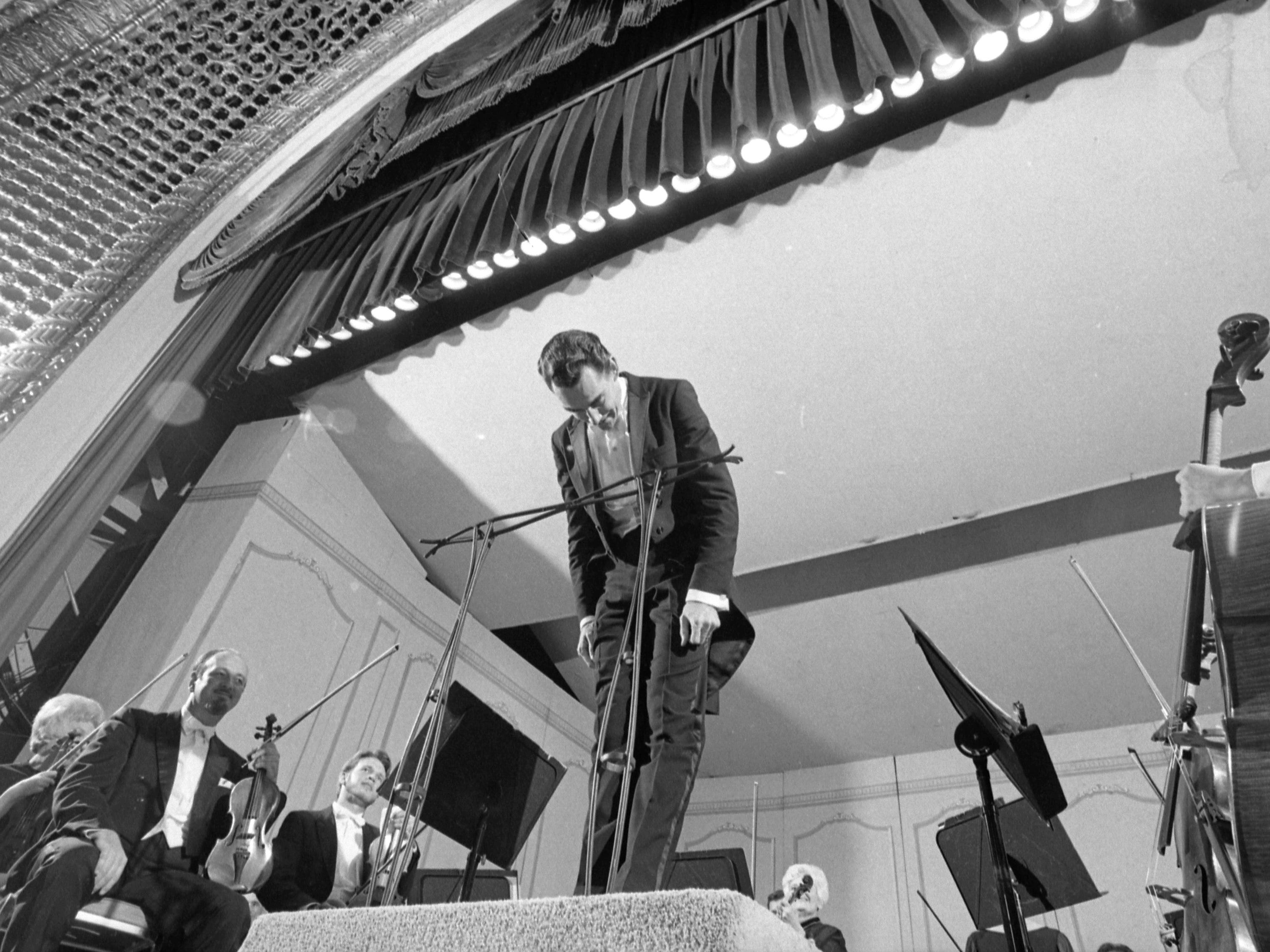 Kenneth Schermerhorn bows to the audience at a Milwaukee Symphony Orchestra performance at the Pabst Theater, during the orchestra's 1968-'69 season, Schermerhorn's first as the MSO's conductor and music director.