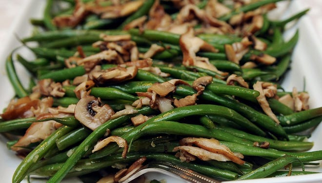 Green beans with wild mushrooms, similar to this dish, is one of the holiday side dishes that will be demonstrated at a cooking class Oct. 29 at the Milwaukee Public Market.