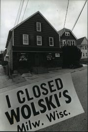 Wolski's is near the intersection of Kane Place & Humboldt Ave in the foreground: The famed bumper sticker.