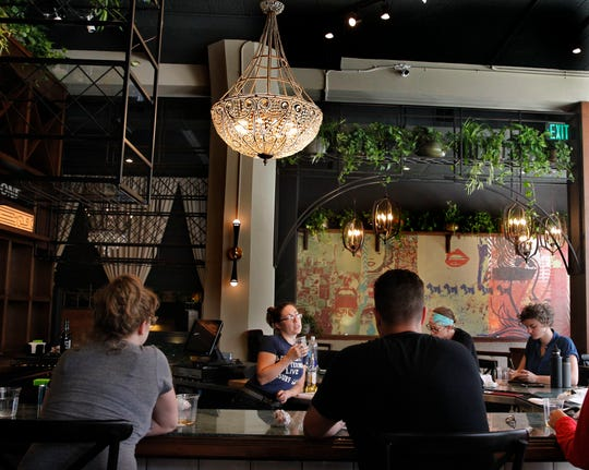 The dining space and bar at Fauntleroy, 316 N. Milwaukee St. in the Third Ward, blended French themes with rock 'n' roll iconography.