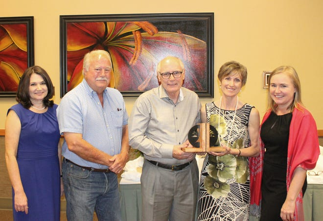 Dr. Tom and Deborah Knox are the 2018 recipients of the Heart of the Library Award. Pictured are: Kim Crow Sheaner, Library Director; Dr. John Ahrens, Vice President, Library Board of Trustees; Dr. Tom Knox; Deborah Knox; and Adeana Estoll, Library Foundation Coordinator.