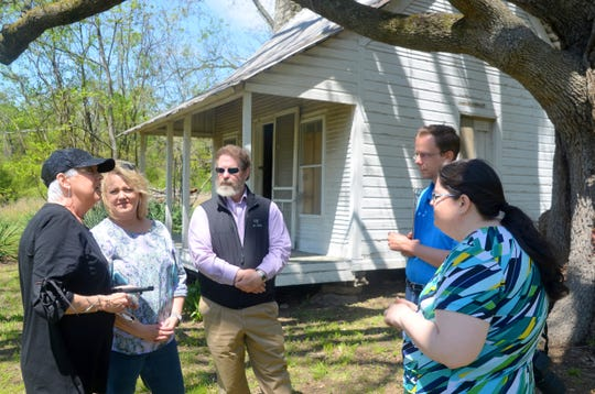 Jennie Haven Johnson (from left) talks about the history of the Old Johnson House to Vickie Fox, Bull Shoals Mayor David Nixon, Arkansas Historic Preservation Program National Register survey/coordinator Ralph Wilcox and AHPP National Register historian Callie Williams. Wilcox and Williams made a site visit to the house on May 1 as part of the nomination process for the National Registry of Historic Places.