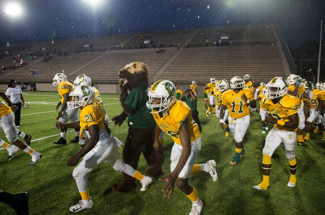 Carver players run on to the field as they are introduced at Cramton Bowl in Montgomery, Ala., on Thursday, Sept. 20, 2018. Carver defeated Dothan 43-7.