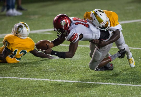 Dothan's Andrew Owens (10) drags a Carver defender into the end zone at Cramton Bowl in Montgomery, Ala., on Thursday, Sept. 20, 2018. Carver leads Dothan 30-7 at halftime.