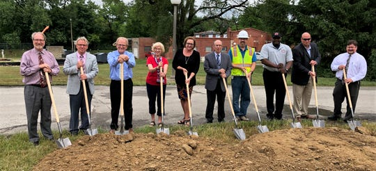 Indiana-American Water Co. President Deborah Dewey, center, is joined by Mayor Dennis Tyler, state Rep. Sue Errington and others at the groundbreaking in June for upgrades to the treatment plant in Muncie.
