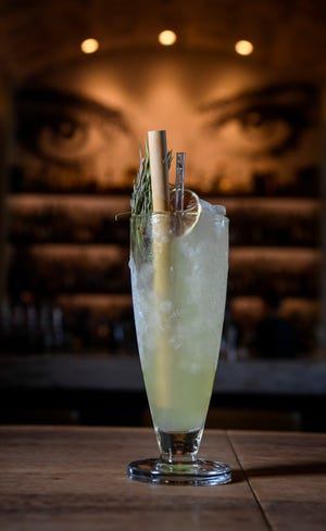 The Attention to Detail cocktail shows off a bamboo straw and a silicone straw at Henley in Nashville on Sept. 21, 2018. The year-old restaurant in the Kimpton Aertson Hotel shelled out more money upfront to invest in plastic alternatives so it could save money in the long run and help protect the environment.