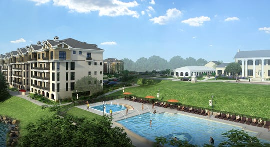 Revery Point's condos are in four-story buildings close to the clubhouse and the pool, as shown in this rendering.