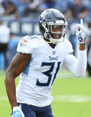 Tennessee Titans defensive back Kevin Byard (31) after throwing a touchdown pass on a fake punt during the first half against the Houston Texans at Nissan Stadium on Sept. 16, 2018.
