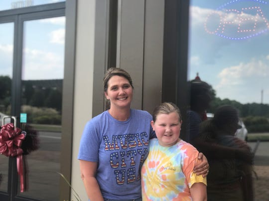 Kilgore's Family Restaurant Owner Keeley Scott and daughter Mikayla Kilgore, 11, stand in front of the restaurant that opened in Pleasant View on Sept. 15.