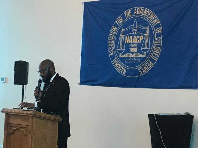 The Rev. James Turner II, who leads New Hope Baptist Church in Nashville, delivers the keynote address during the religious affairs luncheon at the Tennessee NAACP's annual leadership convention.