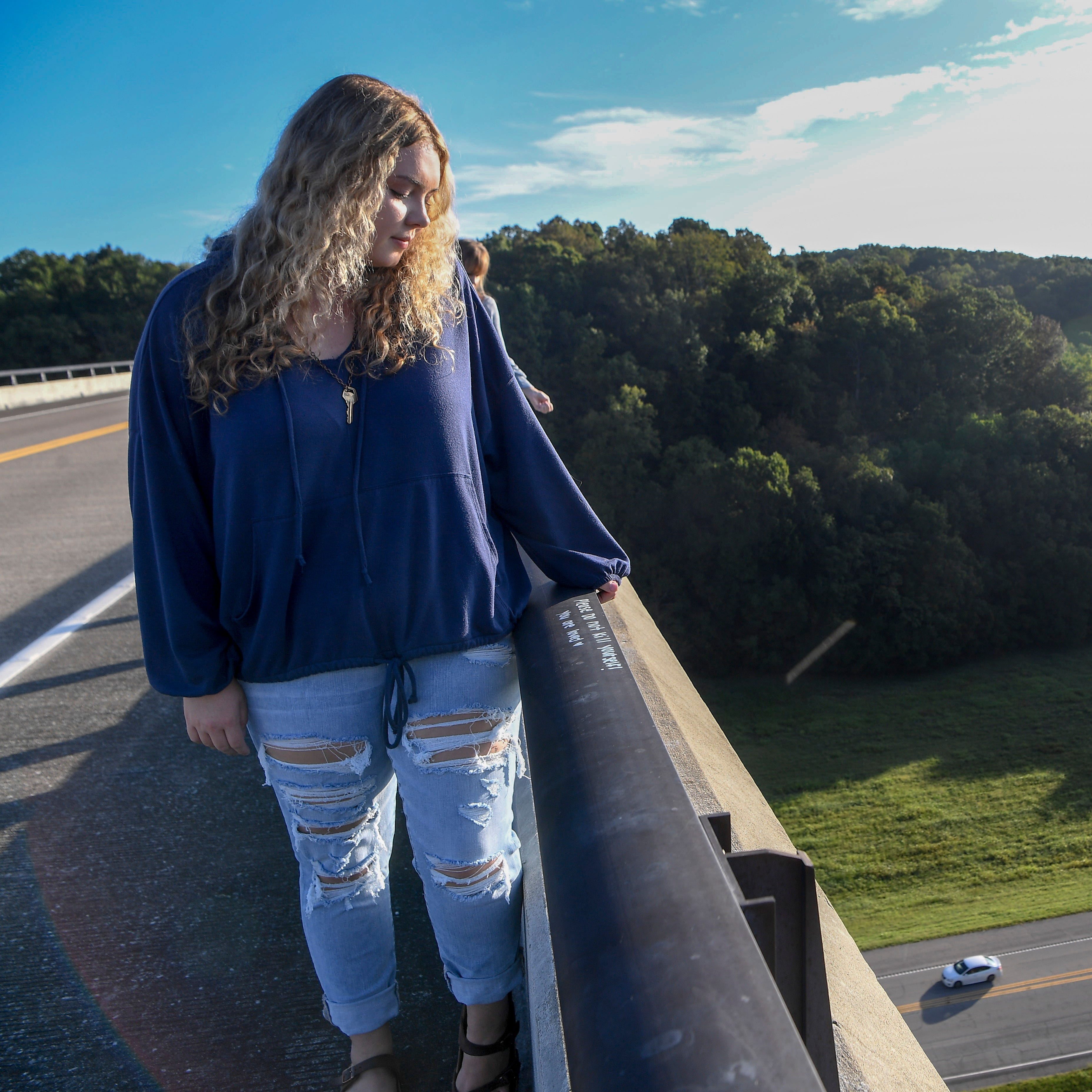 Lauren Clements stands on the Double Arch Bridge where she attempted suicide earlier this year. At 24, the Franklin woman has attempted suicide 13 times.
