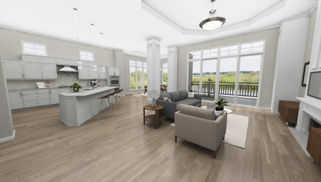 This artist's rendering shows the open floor plan and lake views of residences in the new Revery Point condominiums at Foxland Harbor in Gallatin.