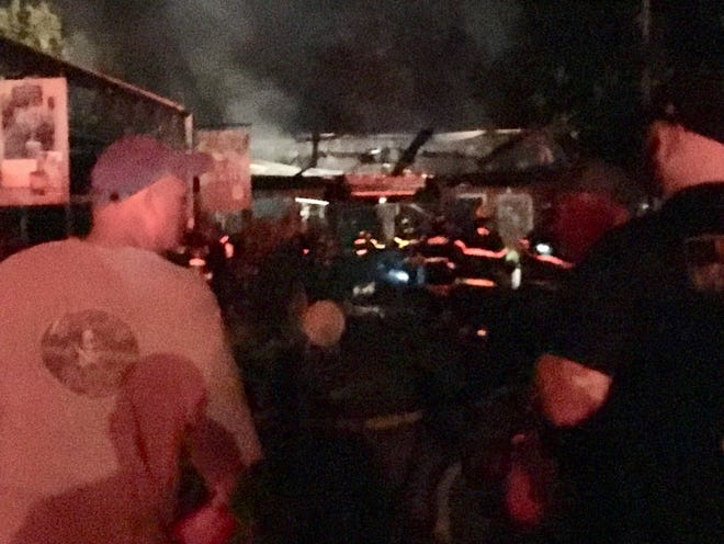 Crews on scene of a fire Thursday morning, Sept. 21, at Creekside Garden Center nursery