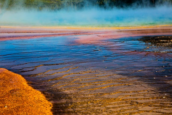 The Grand Prismatic Hot Spring at Yellowstone National Park's Midway Geyser Basin in Wyoming, as seen on Tuesday, Sept. 4, 2018. The multicolored layers get their hues from different species of heat-loving bacteria living in the progressively cooler water around the spring.