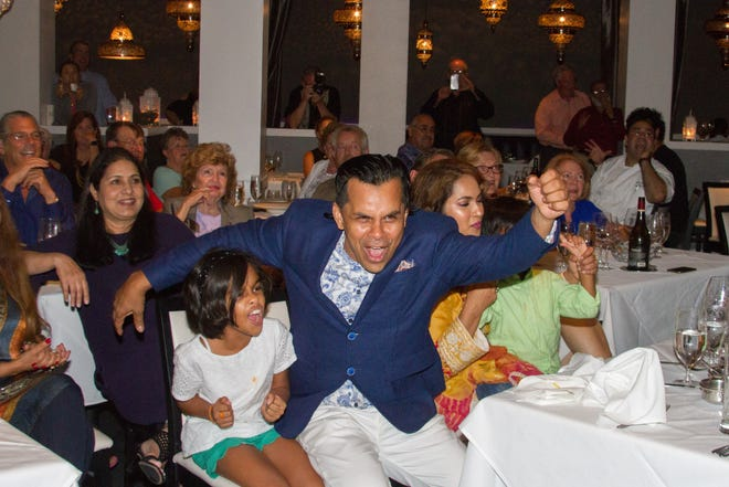 """Chef Asif Syed celebrates his win on """"Beat Bobby Flay"""" during an episode watch party on Sept. 20 at his restaurant, 21 Spices, in East Naples."""