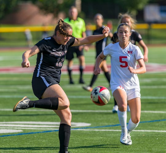 Mary Claire Flynne of Northern Highlands battles with Lily Seifert of Ridgewood for the ball during girls high school soccer action Northern Highlands plays Ridgewood.