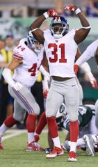 Aug 24, 2018; East Rutherford, NJ, USA; New York Giants co-captain and defensive back Mike Thomas (31) celebrates during the second half against the New York Jets at MetLife Stadium.