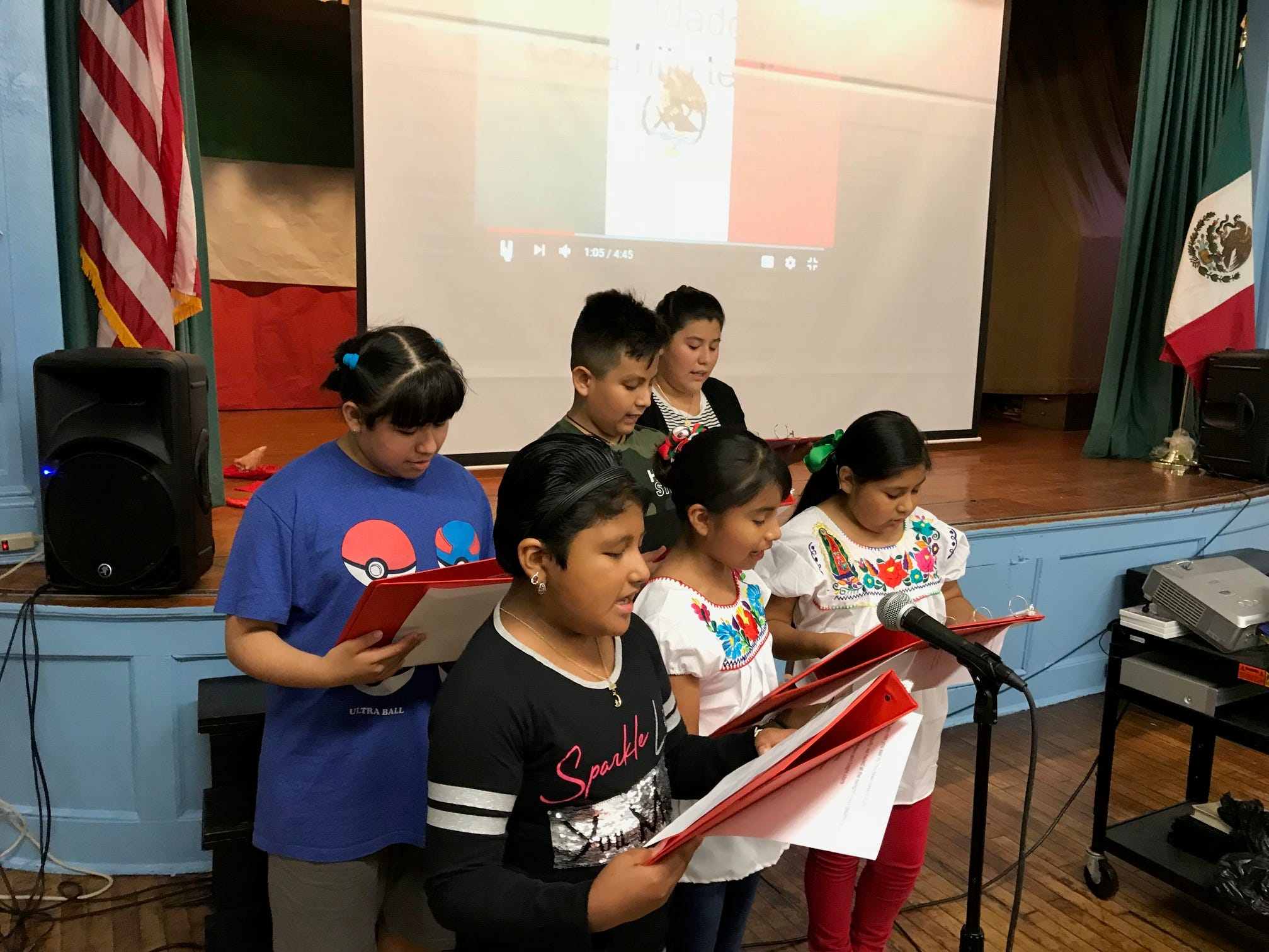 After the singing of the Star Spangled Banner, students at School No. 5 lead audience in the singing of the Mexican National Anthem.