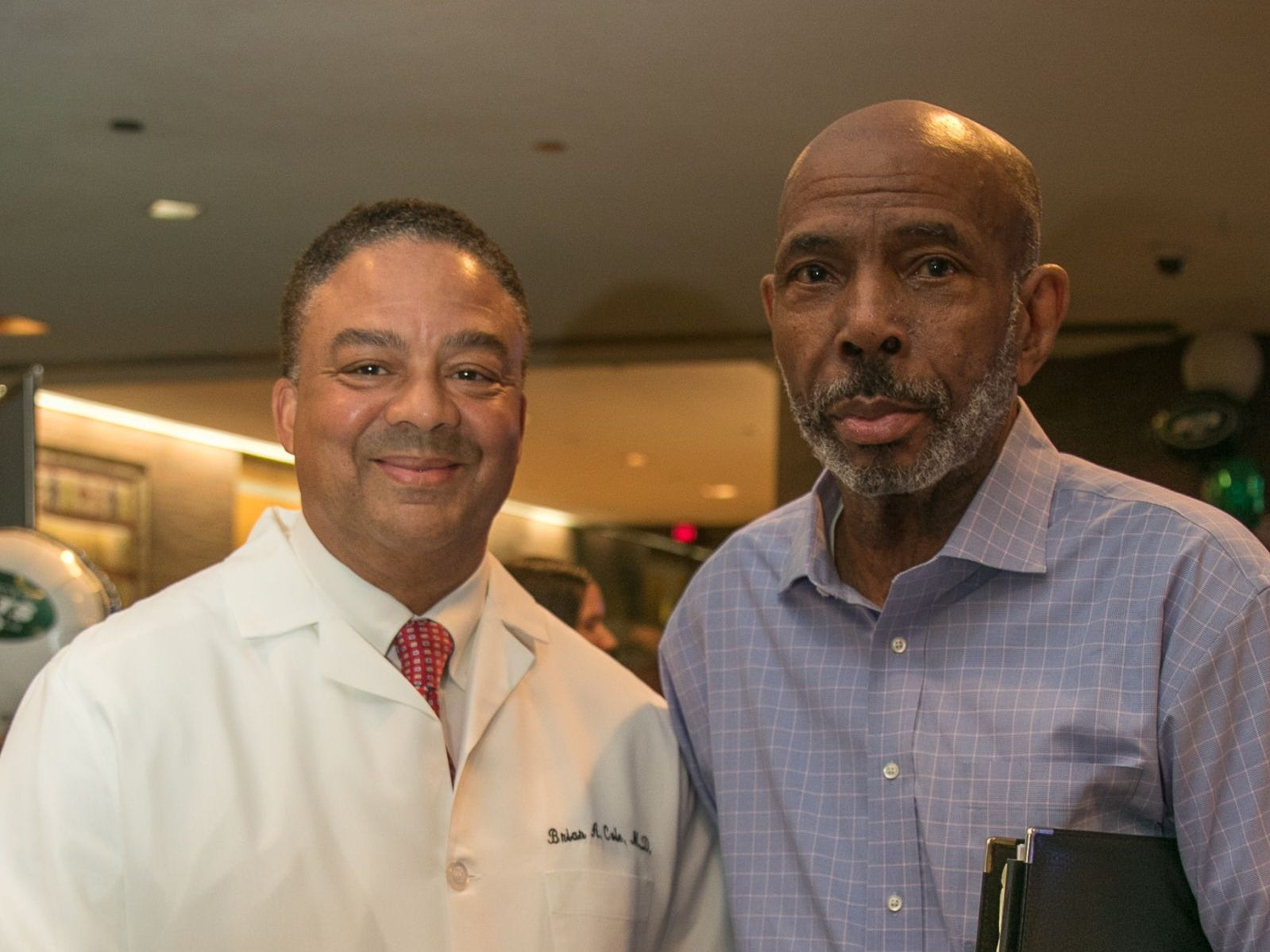 Dr. Brian Cole, Richard Standard. Englewood Health hosted its Men's Health and Football event with former Jets and Giants players and Don La Greca from ESPN radio. Attendees watched the Thursday night football game while receiving advice about staying healthy and tackling health problems early on. 09/20/2018