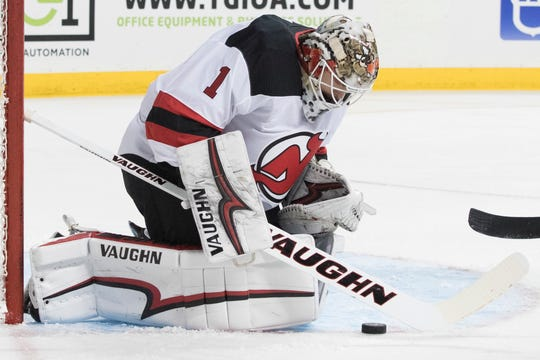 New Jersey Devils goalie Keith Kinkaid makes a save during the second period of a preseason NHL hockey game against the New York Islanders, Thursday, Sept. 20, 2018, in New York.