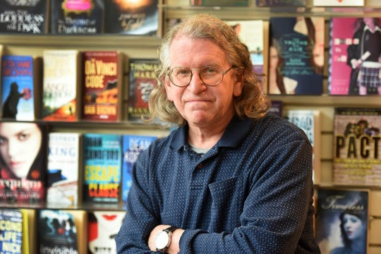 Tom Downs, owner of Shaw's Book Shop, a independent book store in Westwood that has been in business for over 40 years and is closing at the end of the month
