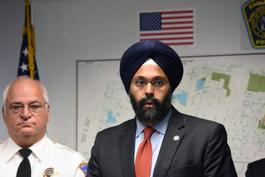"Michael Saudino, Bergen County Sheriff and Gurbir S. Grewal, Acting Bergen County Prosecutor at the press conference announcing the results of ""Operation Safe City"" – a joint initiative by the Bergen County Prosecutor's Office, the Englewood Police Department, and the Bergen County Sheriff's Office, targeting the rise in gun violence in Englewood, October 27, 2016."