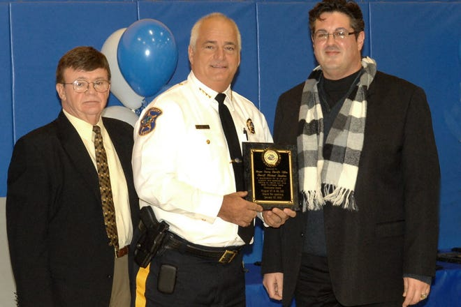 In 2012, Mike Nardino Executive Director of the Lodi Boys & Girls Club and Paul Raguso 1st Vice President of the Board of Directors present Bergen County Sheriff Mike Saudino with a plaque in recognition of his efforts in the reconstruction after the Club's building had suffered devastating damage from Tropiclal Storm Irene.